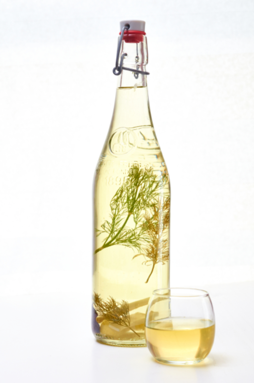 colored spirits vodka herbs beverage alcohol drink color liquid object booze isolated bottle glass yellow