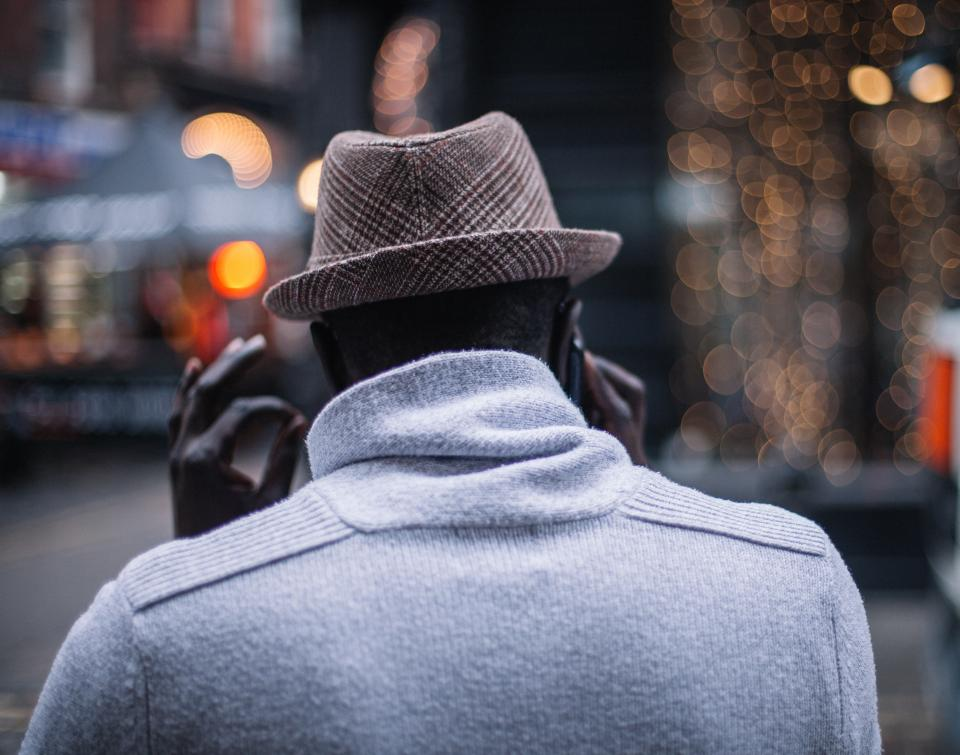 people man male back hat talking mobile phone communication bokeh travel black african american