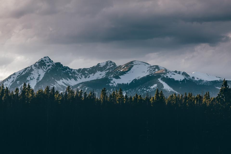 mountain highland dark cloud sky summit ridge landscape nature valley trees plant forests