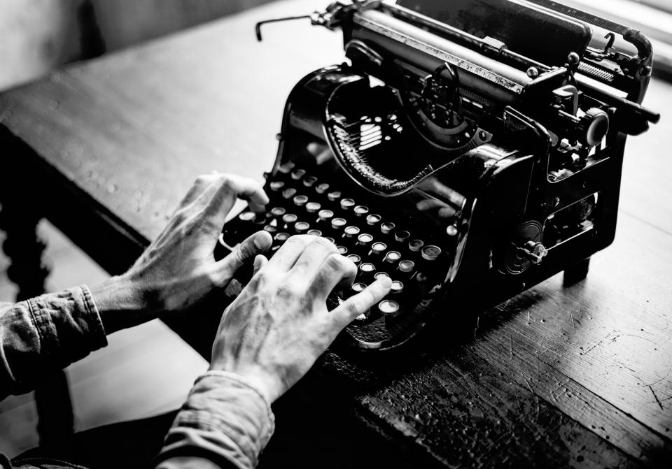 lifestyle people man guy typing typewriter working black and white grayscale