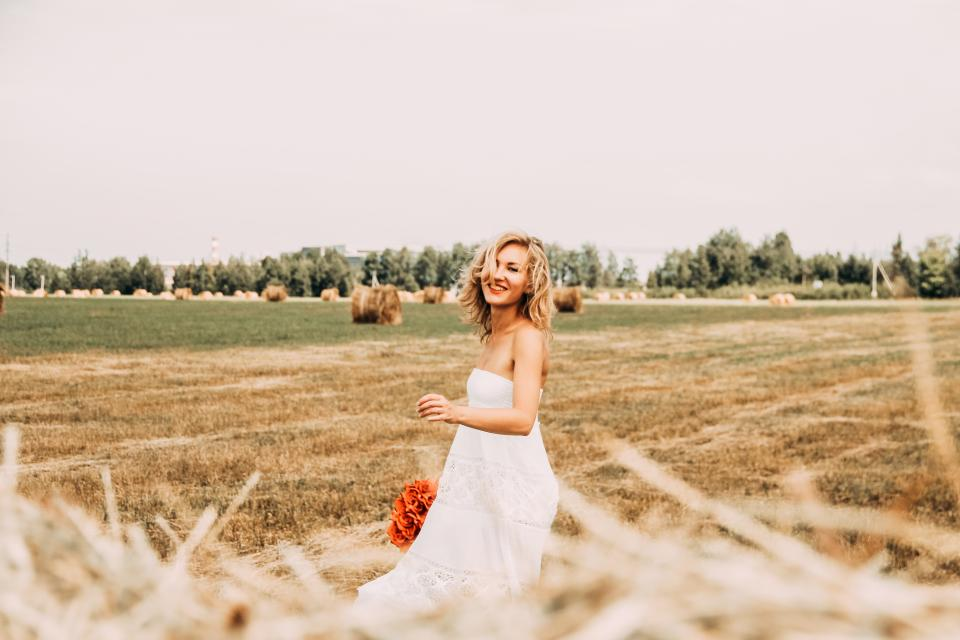 people woman fashion beauty bohemian flower red bouquet happy field plant green trees blonde dress bohemian smile smiling