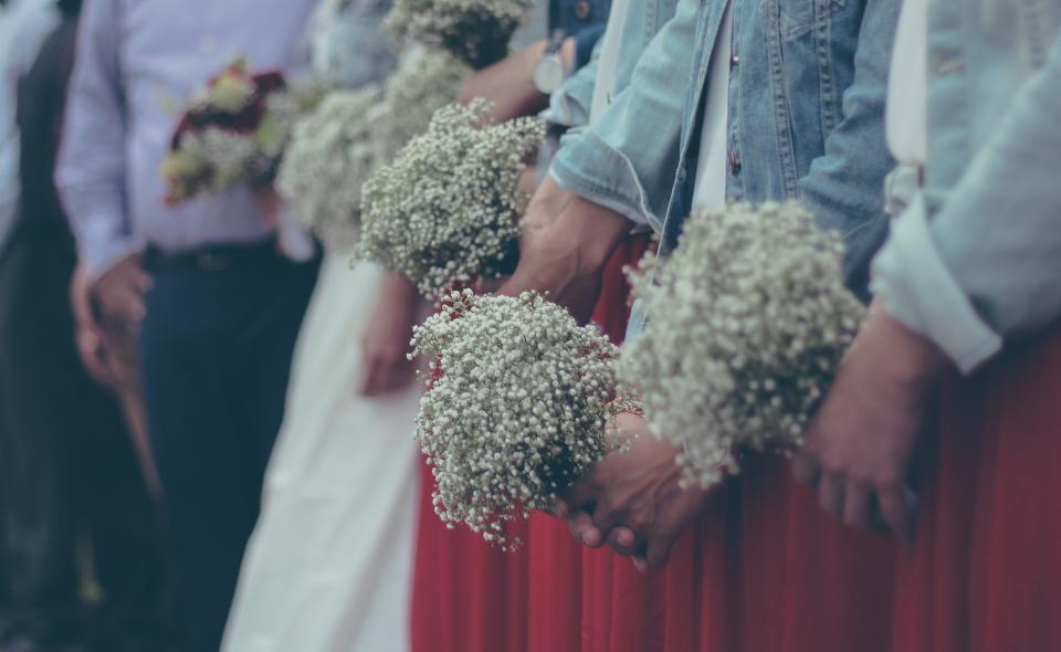 people standing wedding bride groom woman hand flowers