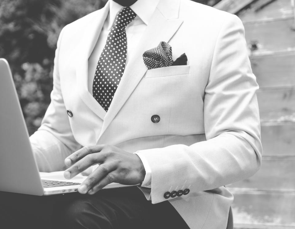 suit blazer tie pocket square fashion guy man gentleman laptop computer technology working business creative black and white people lifestyle