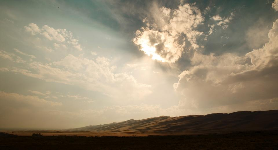 sky clouds sunlight sunrays sunny desert sand hills