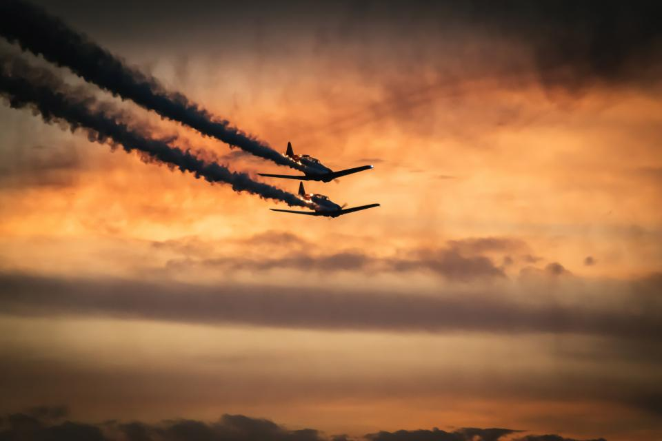 airplanes jets aviation orange sky sunset dusk clouds transportation travel