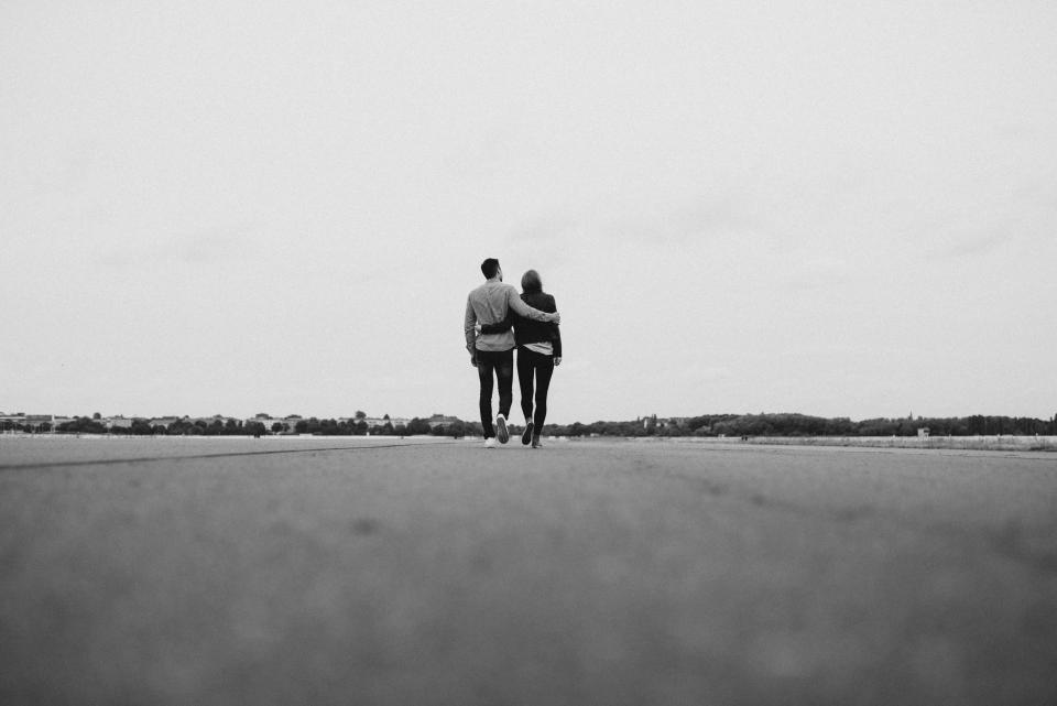 road field people couple walking outdoor hug love black and white travel