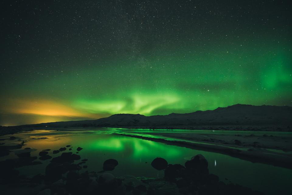 nature landscape dark night aurora borealis stars stargazing astrophotography green mountain shadow water river lake