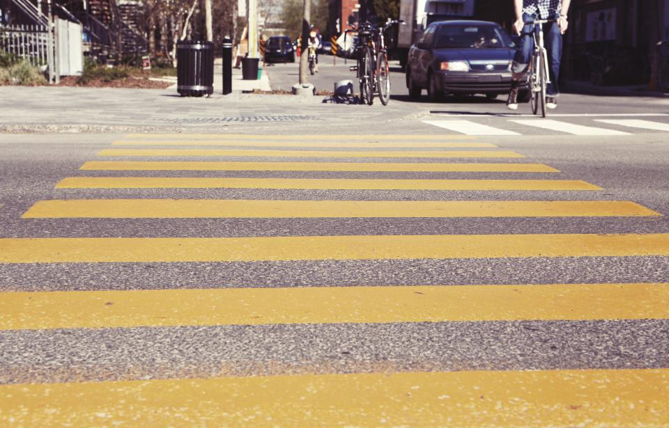 crosswalk crossing streets roads bikes bicycles pedestrians cars city