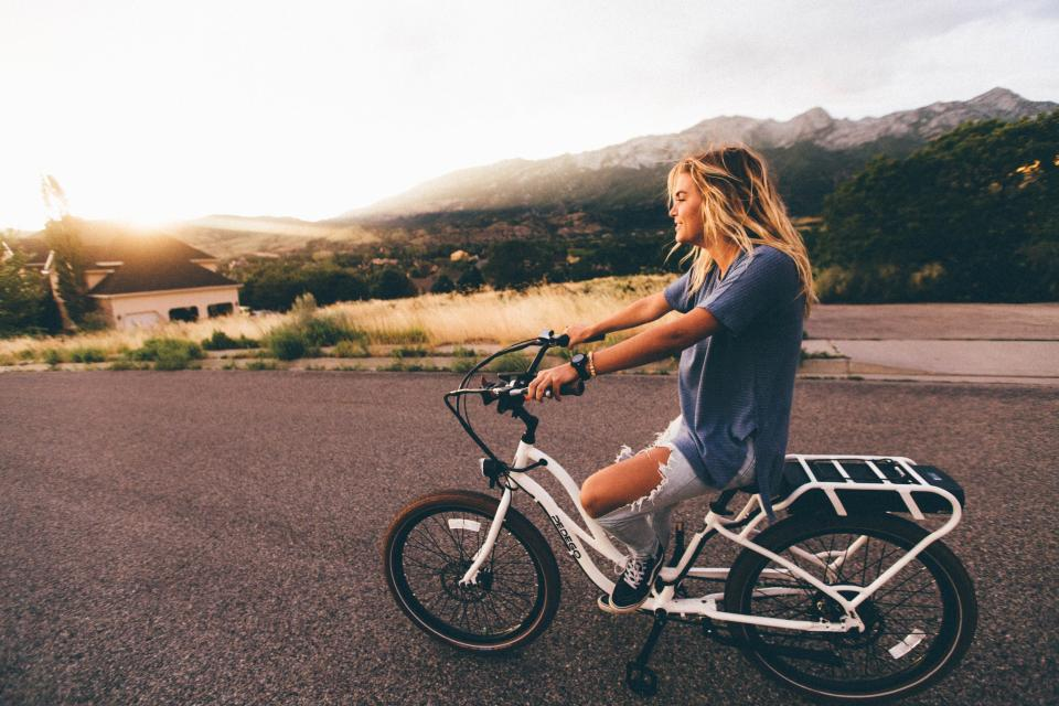 girl woman bike bicycle blonde people lifestyle road model beautiful pretty landscape outdoors sunset mountains pavement jeans beauty