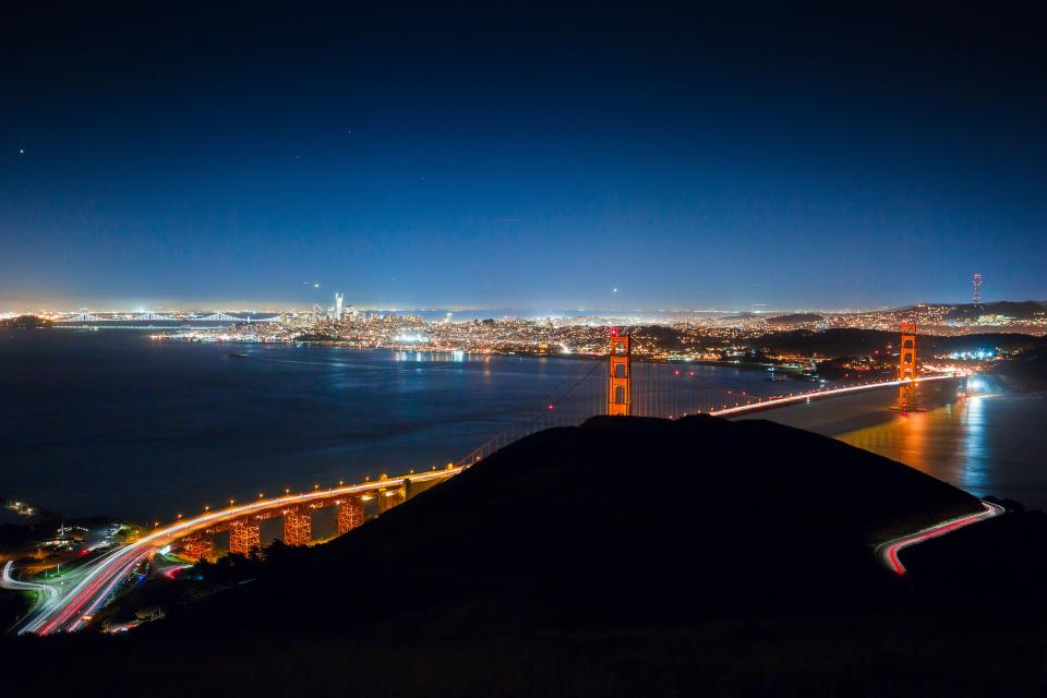 architecture building infrastructure mountain highland road lights skyline city urban night sky golden gate bridge landmark transportation travel