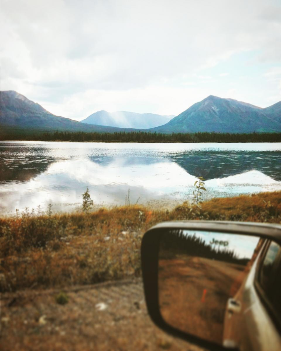 mountain highland landscape nature blue sky clouds view lake water grass car mirror vehicle travel outdoor reflection
