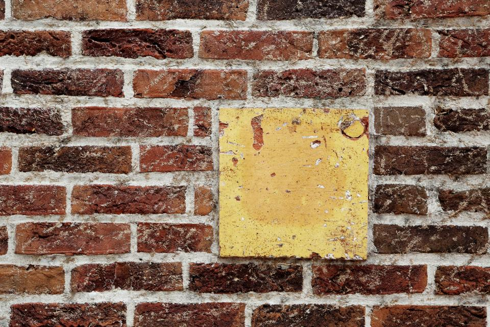 red bricks wall yellow squre pattern texture