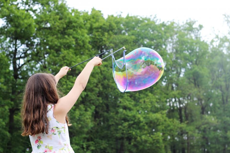girl child people back play bubble kaleidoscope colors trees sky