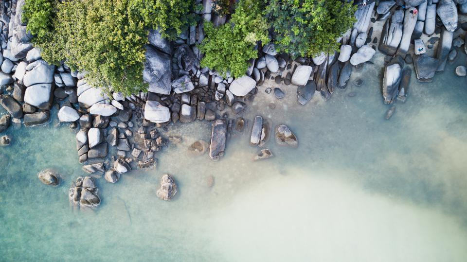 sea ocean water wave nature rocks stone coast trees plants nature aerial