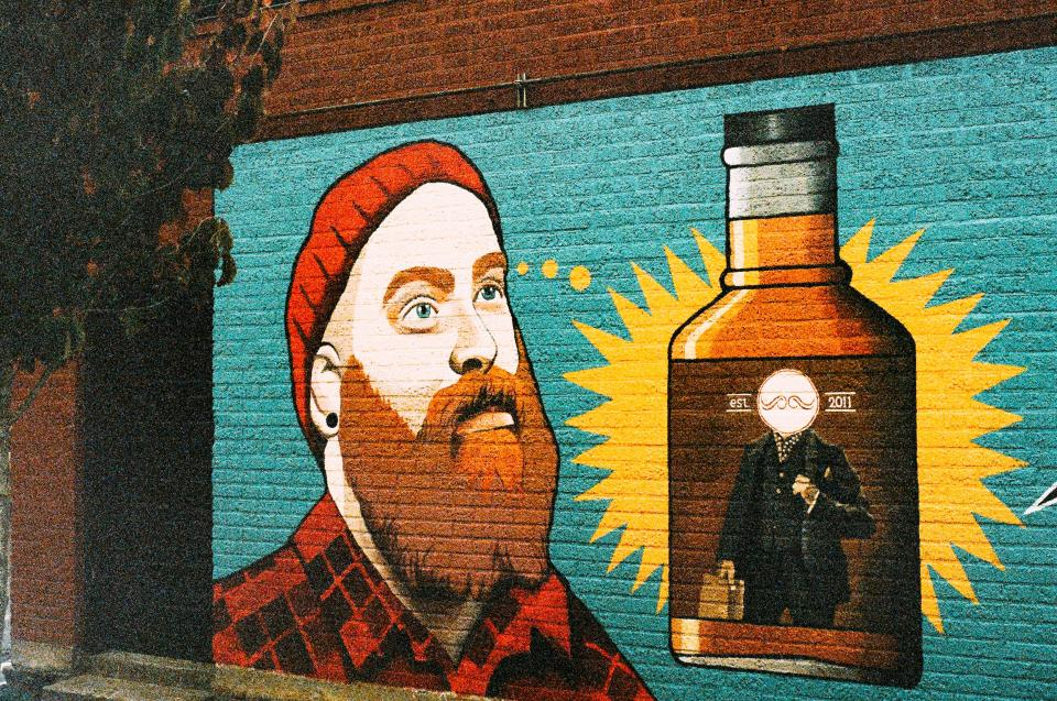 wall paint graffiti man orange beard hat toque plaid hipster alcohol booze whiskey