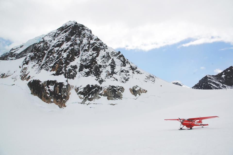 nature landscape mountain travel adventure snow winter cold weather white clouds sky helicopter airplane