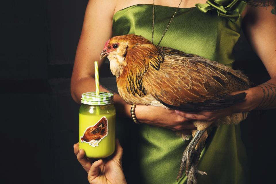 people woman gown bird chicken animal pet drink juice beverage glass jar