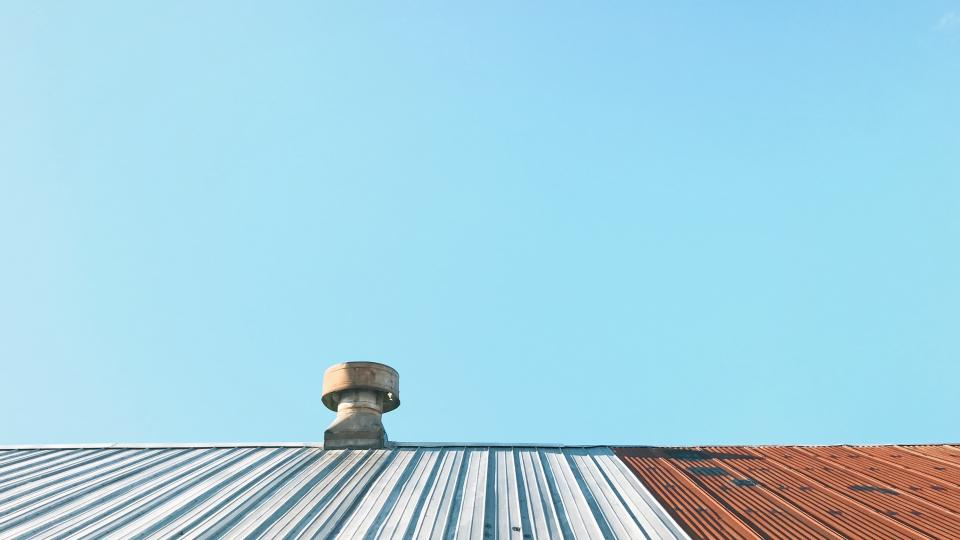 roof skyscraper steel exhaust fan sky blue