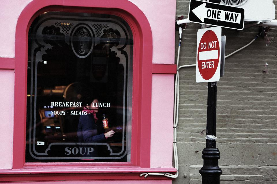 restaurant pink window breakfast lunch soups street signs one way post do not enter