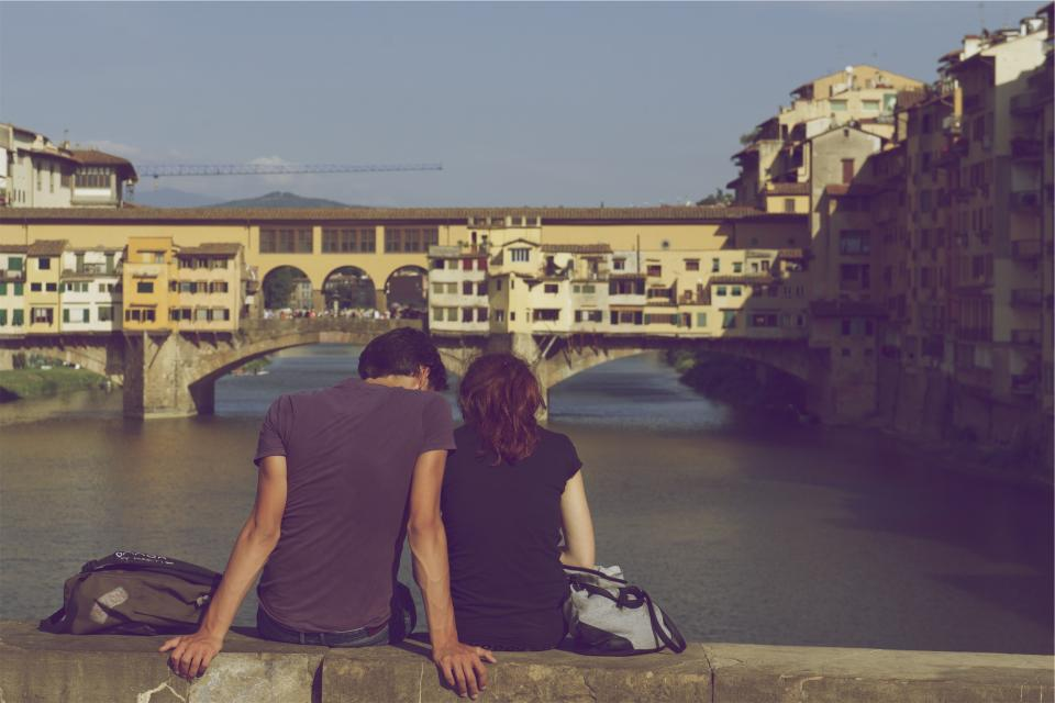 people couple love romance romantic backpack purse bridge water buildings architecture city sunshine crane