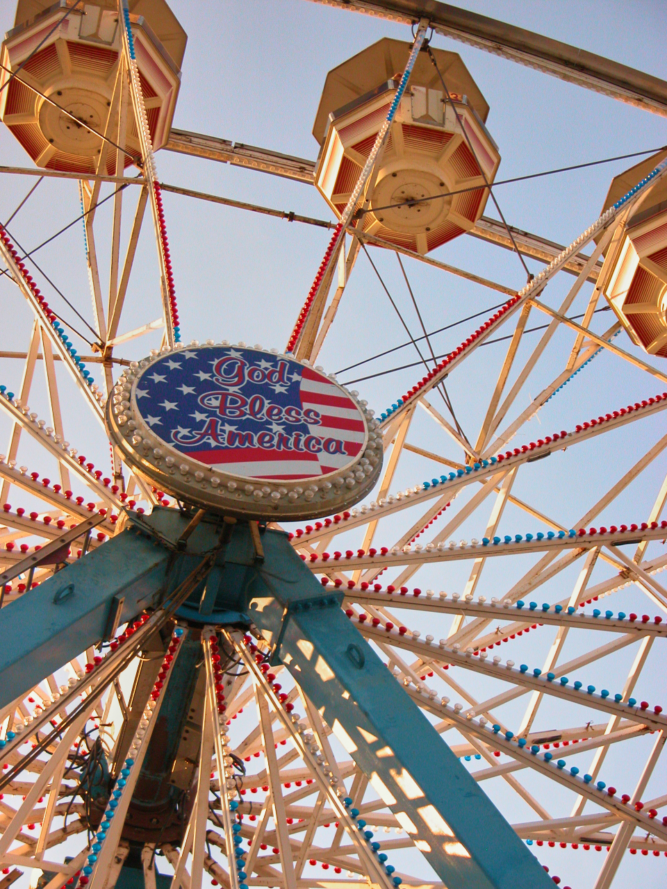 carnival ferris wheel ride fun festival entertainment fairground recreational retro amusement fair sky vintage leisure play tall blue america flag