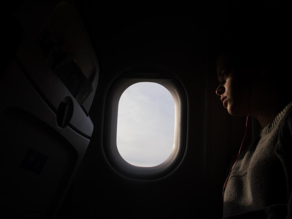 window dark inside airplane airline people girl travel trip flight