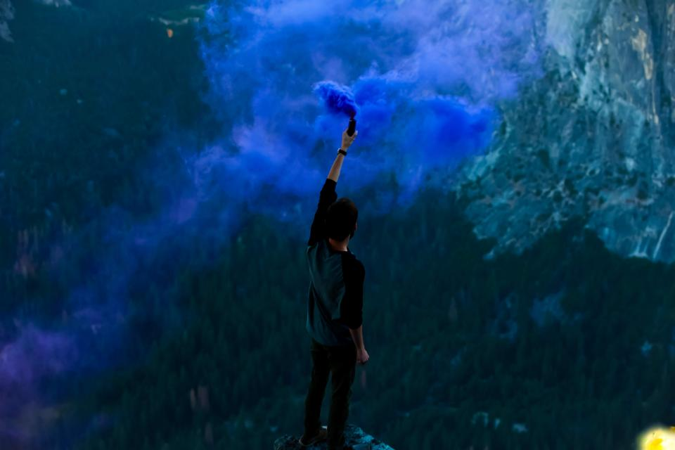 blue smoke flair guy man people nature mountains outdoors adventure