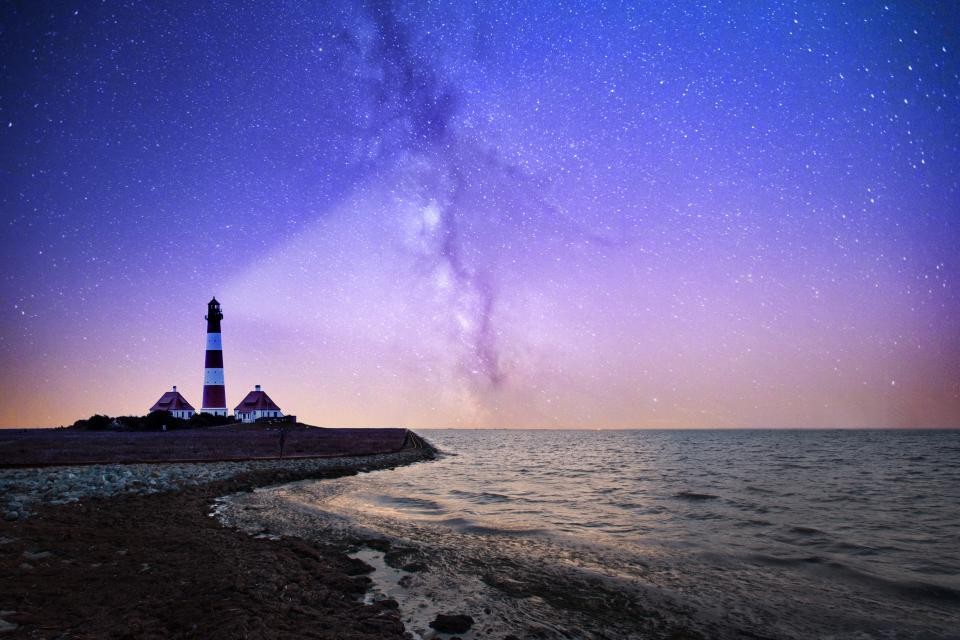 sea ocean water waves nature coast beach shore night sky stars horizon lighthouse
