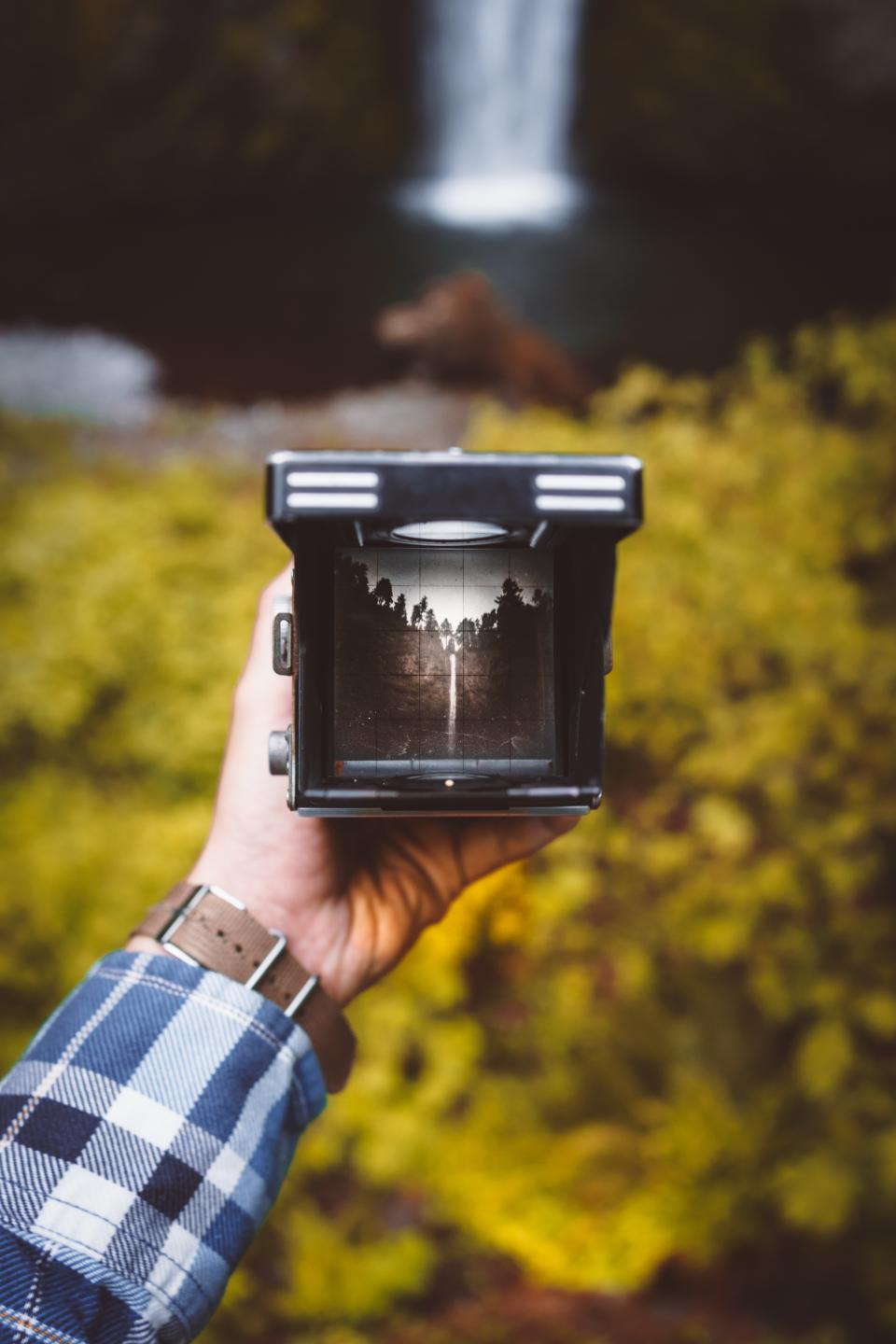 camera photography photo photographer people hands old vintage film green leaves plant trees falls nature water checkered flannel accessories watch