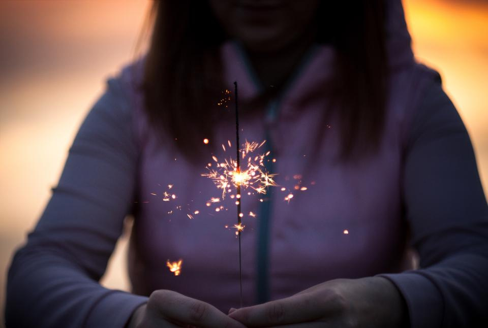 sparkler lights fire flame blur people girl