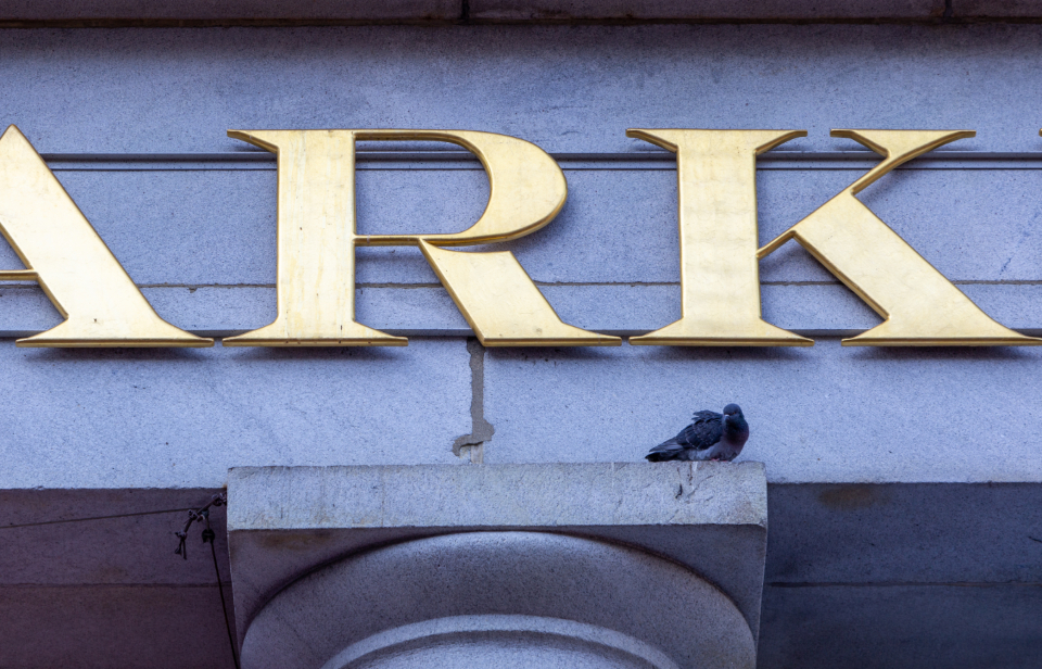 sign building exterior city detail typography bird column structure facade architecture business letters signage