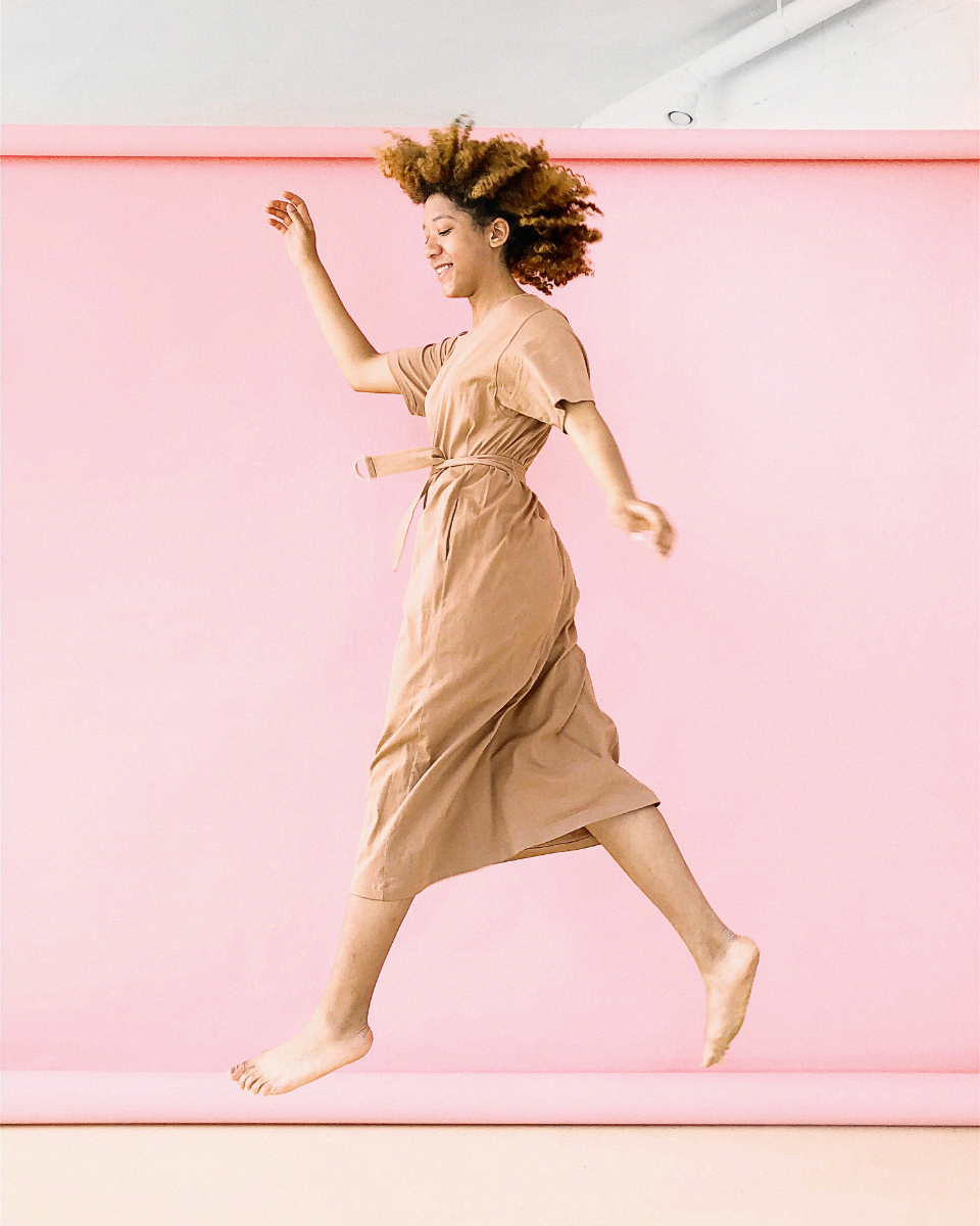 woman jumping pink background hair dress bare feet people girl pretty female elegant