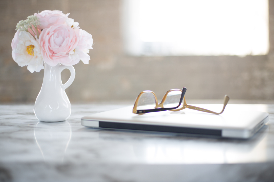 reading glasses desk laptop flowers office table marble interior window freelance writer vase decor decoration computer technology