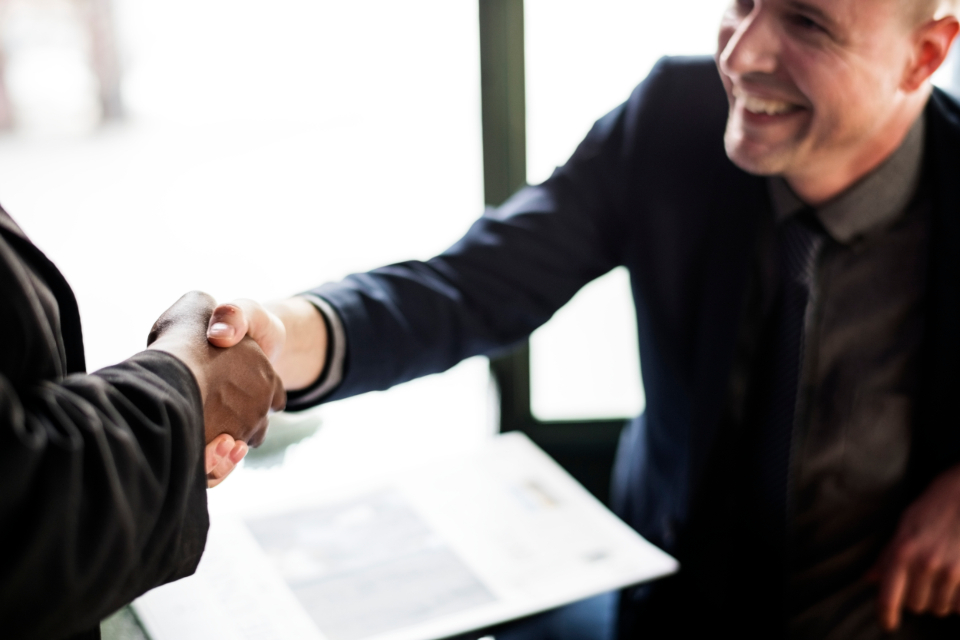 accomplished agreement business business agreement business deal collaboration colleague communication congratulating cooperation deal gesture greeting hands handshake help helping hands man meeting partners partnership people