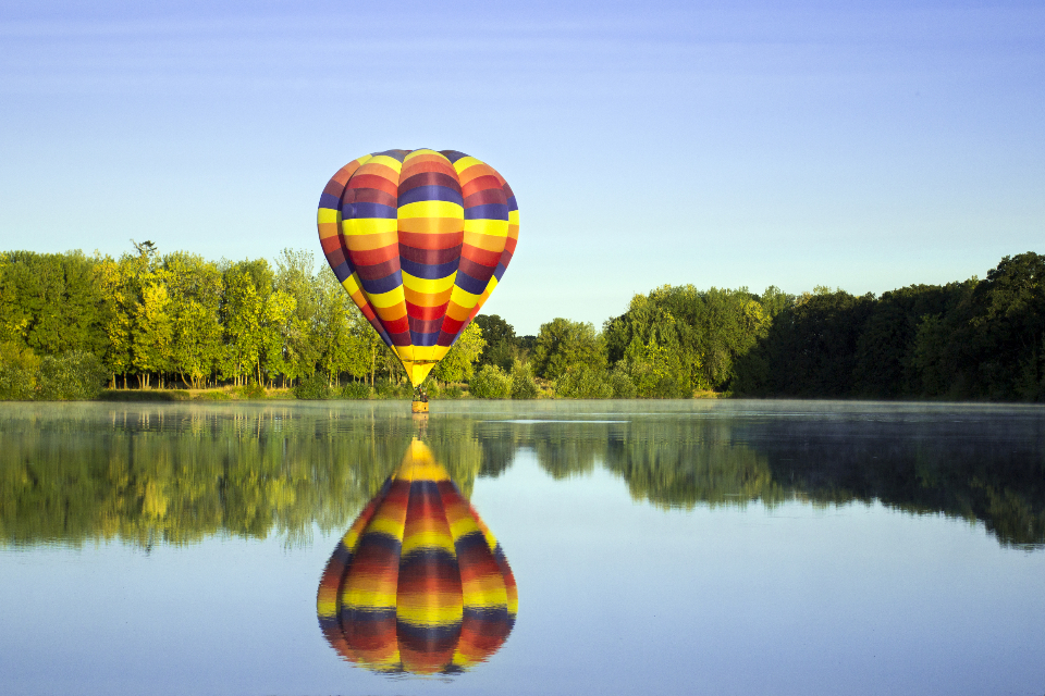 hot air balloon lake reflection nature outdoors activity flying floating trees sky beautiful colorful fun hobby scenic adventure freedom landscape sport