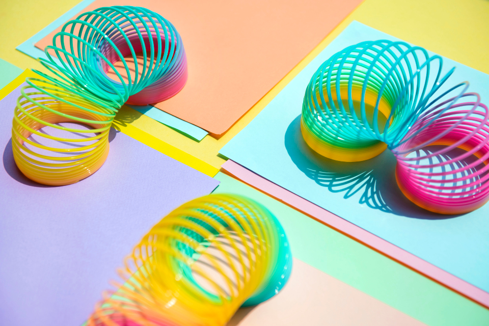 abstract amusement background bright childhood closeup coil colored colorful enjoyment entertainment equipment flexibility flexible fun funky game leisure macro memories motion object pattern plastic play rainbow recreation spectrum spiral sp