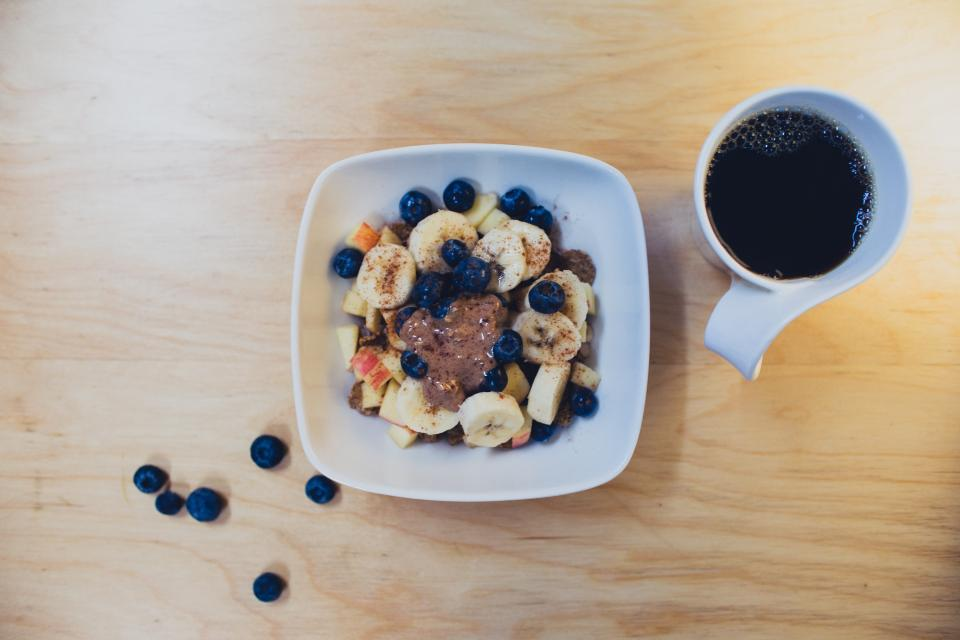 bananas blueberries fruits apples bowl breakfast morning coffee cup mug table healthy