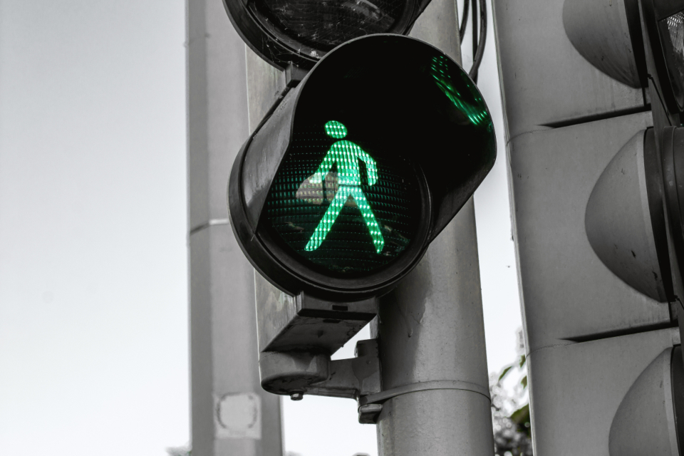 crosswalk green man traffic lights stop go sign highway road