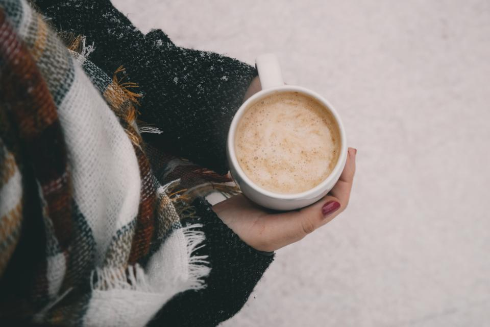people woman coffee cream hands manicure red scarf cold weather