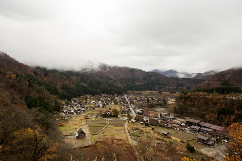 Shirakawago village Japan town agriculture houses landscape cloudy mountains