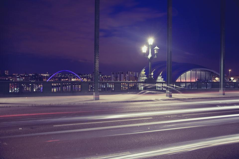 architecture buildings city bridge urban metro downtown time lapse night lamps lights posts nature sky clouds violet
