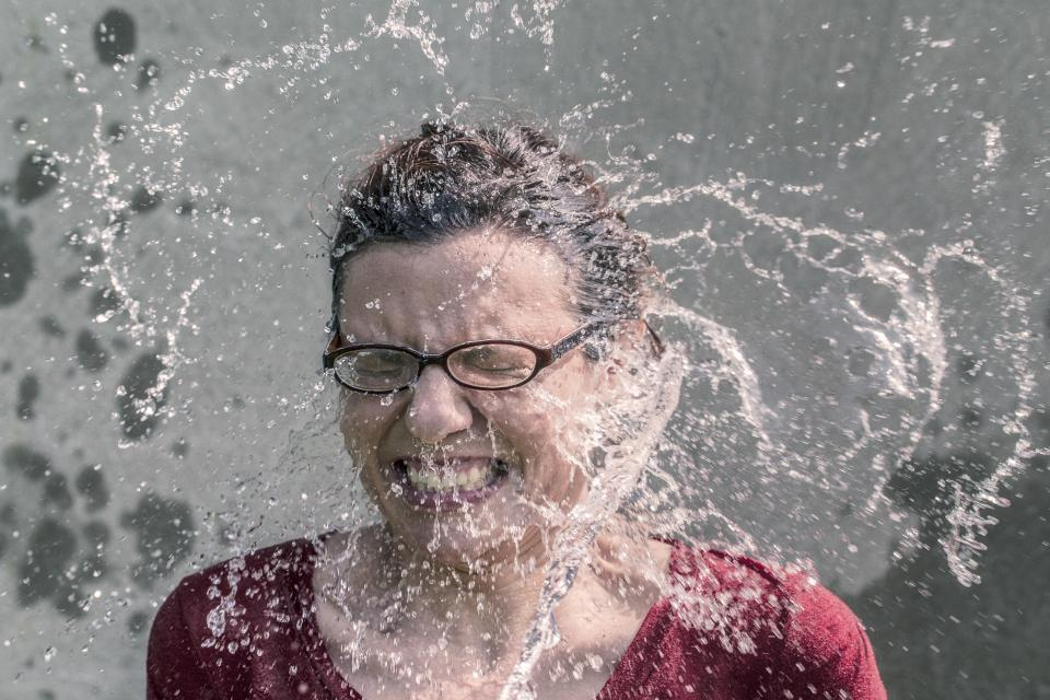 water splash wet girl woman face glasses mouth teeth hair people