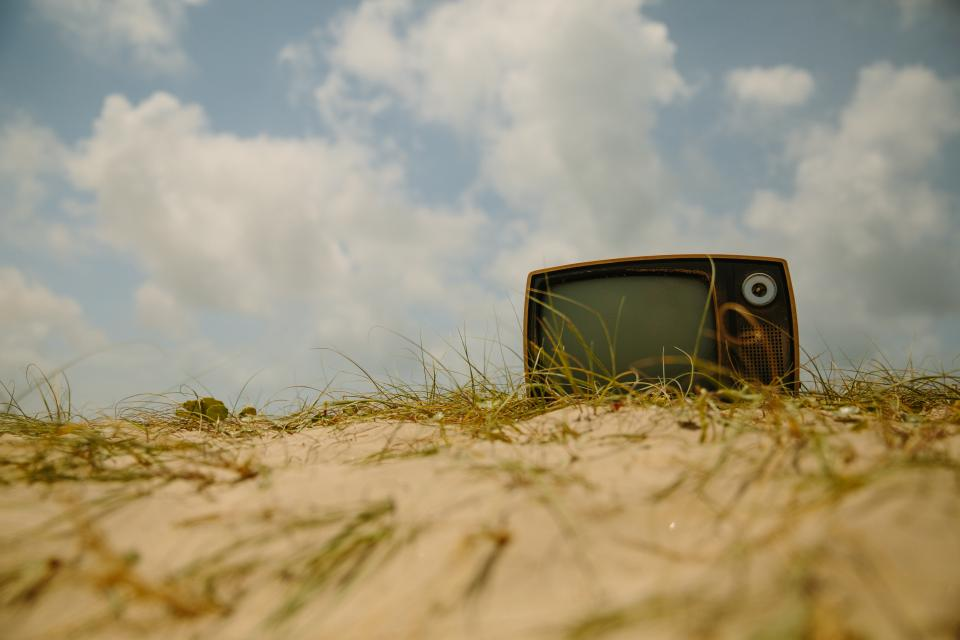 tv television vintage oldschool ground sand sky clouds
