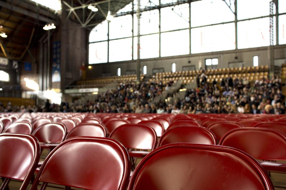red chairs seats stands hall gym stadium crowd spectators windows