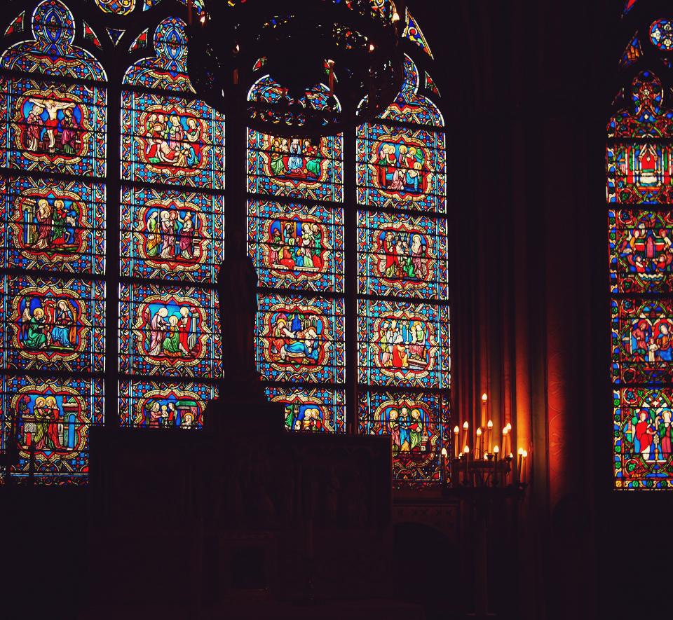 Notre Dame Cathedral Paris France stained glass windows candles dark religion catholic