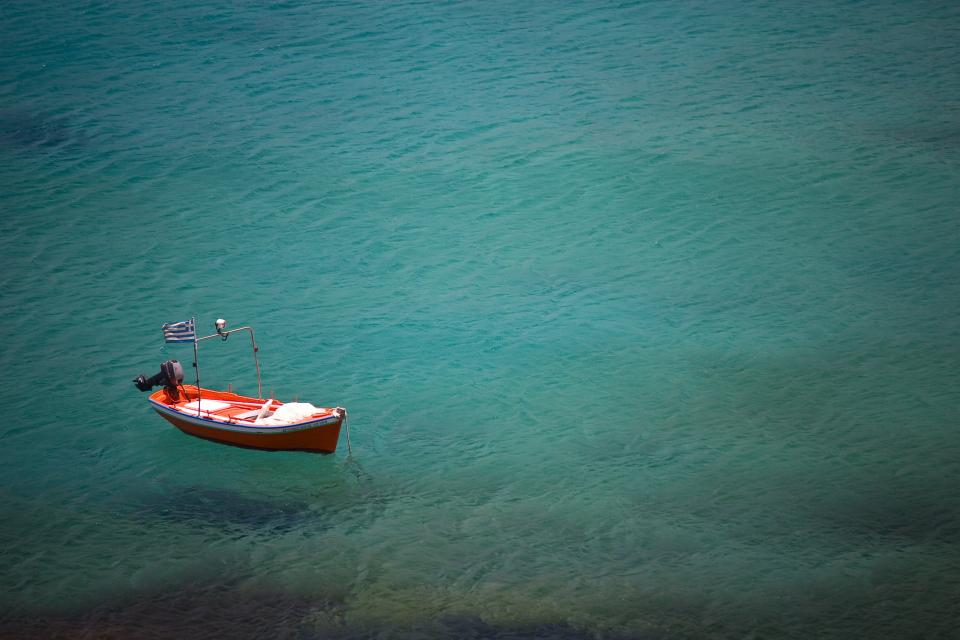 clear green water greece flag red boat motor peaceful sea