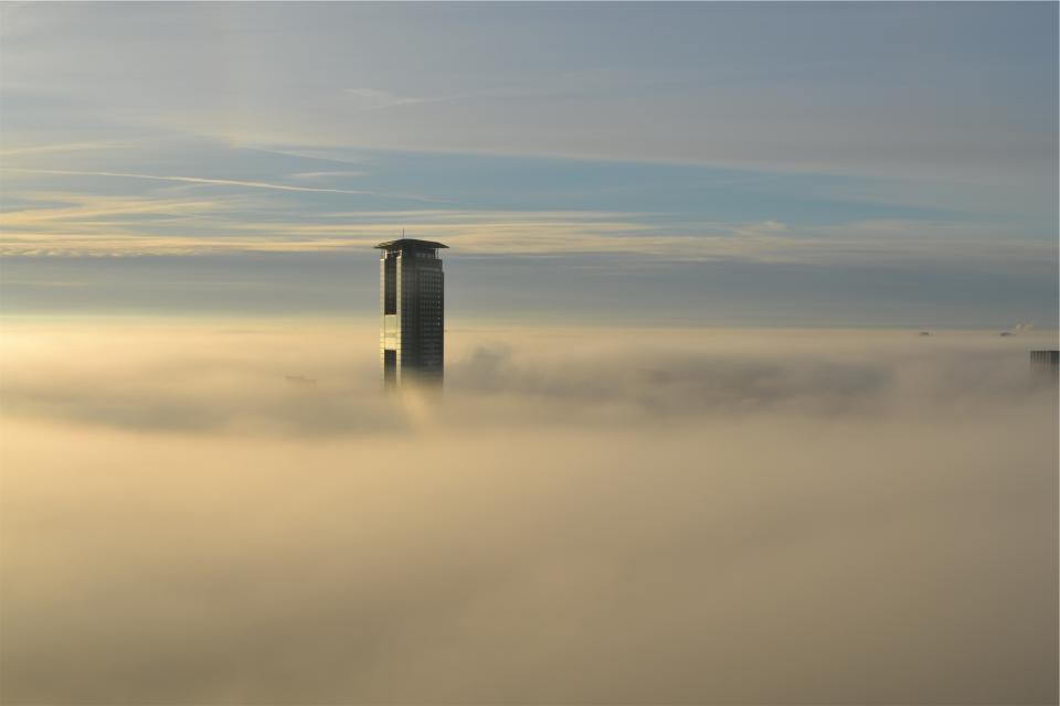 building tower high rise skyscraper architecture above the clouds sky