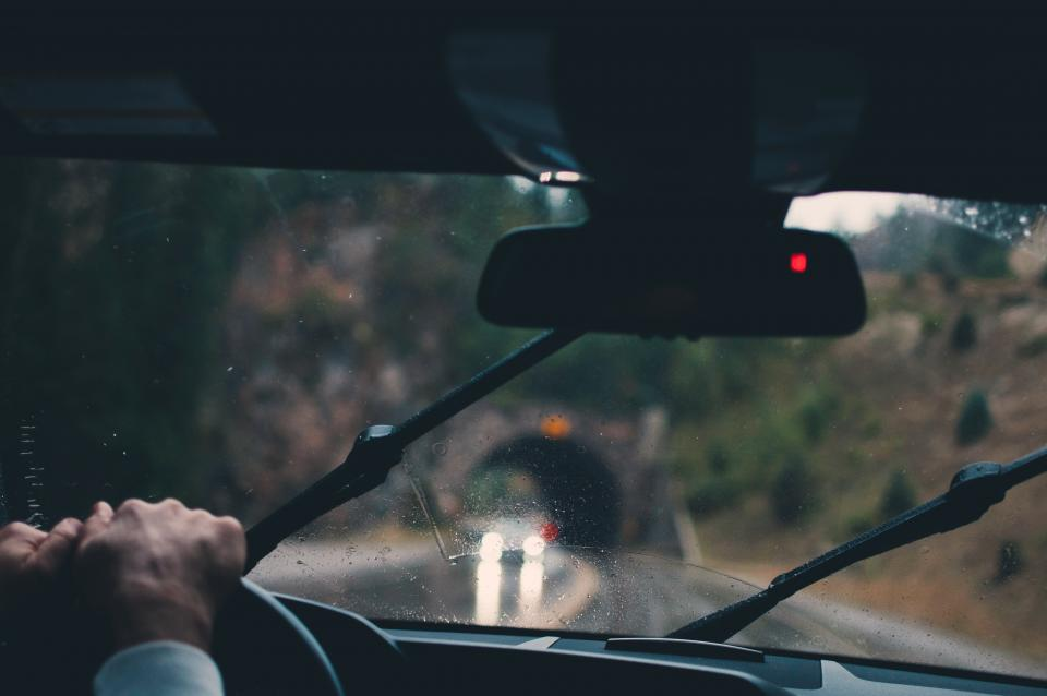 car vehicle auto automotive travel street road trip people driving ride wet raining blur