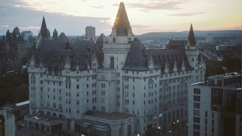 Chateau Laurier hotel Ottawa Ontario Canada buildings architecture flags sky condos downtown city