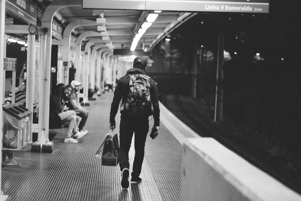 guy man subway metro train station transportation city urban lifestyle people shopping black and white